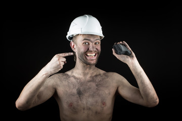 Coal miner on a black background