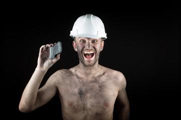 Coal miner on a black background