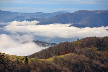 Clouds rise above the valleys in the Carpathians