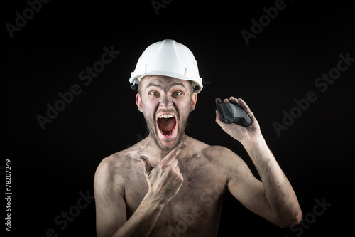 Coal miner on a black background - 78207249
