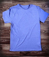 Blue t-shirt on wood background