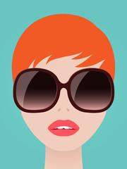 Pretty redhead woman in trendy sunglasses