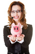 Happy call center woman with piggy bank.