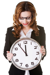 Business woman holding big clock.