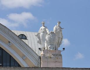 Soviet statue on roof of passenger train station in Kharkiv