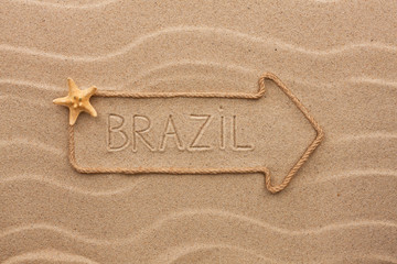 Arrow made of rope and sea shells with the word Brazil on the sa