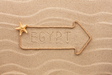 Arrow made of rope and sea shells with the word Egypt  on the sa