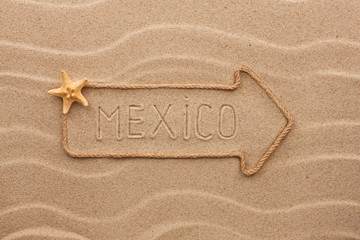 Arrow made of rope and sea shells with the word Mexico on the sa