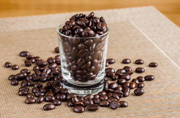 Coffee beans in glass shot with warm tone