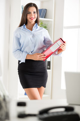 Pretty Businesswoman With Binder