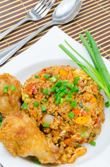A plate of oriental food Special fried rice with chicken