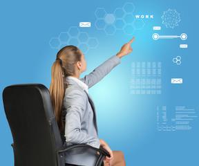 Businesswoman pressing virtual interface