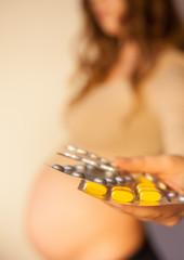 Pregnant woman uses vitamin tablets