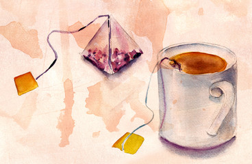 A tea bag and a tea cup on tea-stained distressed background