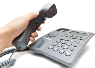 man holding up the phone receiver