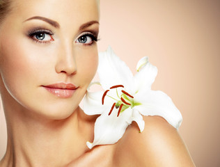 Face of a Beautiful woman with  clean skin and white flower