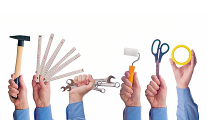 Male worker's hand holding various craft trade tools