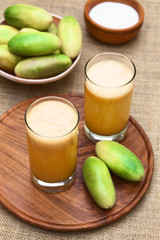 Banana passionfruit (lat. Passiflora tripartita) fruit juice