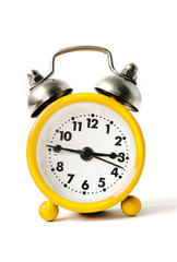 yellow alarm clock on a white background