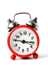 red alarm clock with white dial