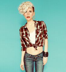 Fashionable blonde girl on blue background. country style