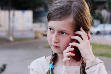 beautiful happy girl tslking on the phone