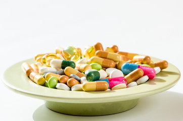 pills on plate isolated