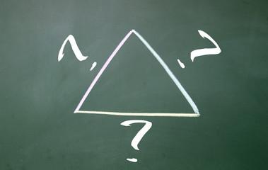 question triangle symbol on blackboard