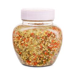 Jar of herbs, spicees and salt seasoning blend