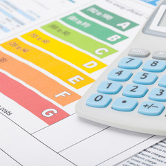 Colorful energy efficiency chart with calculator - studio shot