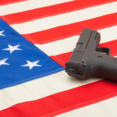 Handgun over US flag - studio  shoot