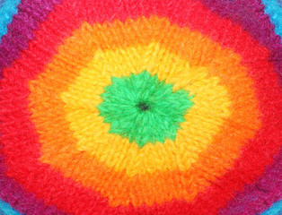 Closeup of rainbow rasta cap. Homemade knitted product.