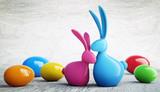 Osterhasen-Paar pinkblau  mit bunten Eiern