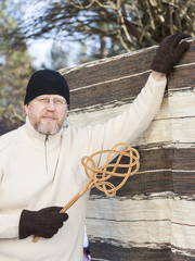 Man with a Carpet Beater