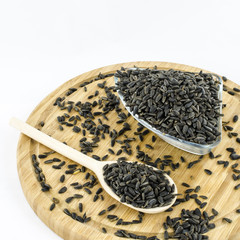 Sunflower seeds on wooden board. Healthy vegetarian food.