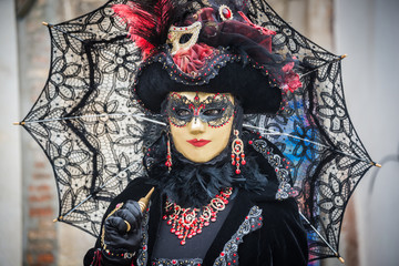 Venice, Italy - February 13, 2015: A wonderful mask participant
