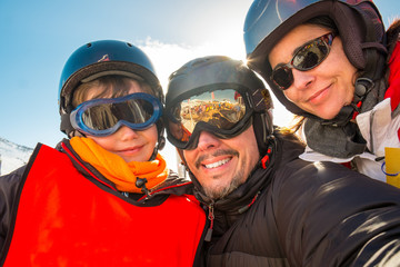 Selfie family winter vacations, skiers, snow