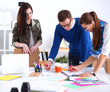 canvas print picture - Young business people working at office on new project