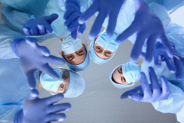 Large medical team standing grouped in a circle