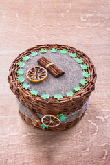 wicker basket without handle on old wooden board