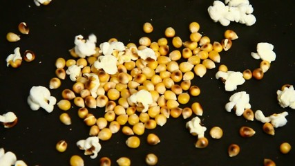 homemade popcorn cooking in slow motion in a pan