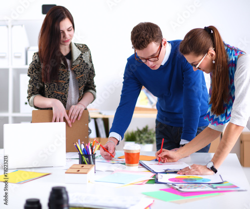 canvas print picture Young business people working at office on new project