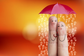 Finger art of a Happy couple. Lovers are holding umbrella.