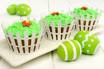 Spring cupcakes with white picket fence and Easter eggs