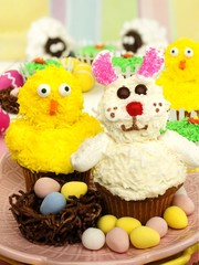 Colorful Easter or spring themed animal cupcake display