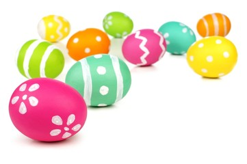 Colorful painted Easter egg border or background over white