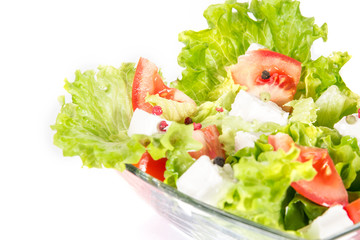 Close up green salad isolated on white