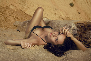 Sexy girl lying on the beach.