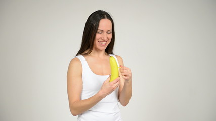 young beautiful woman eating a banana