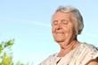 Senior happy woman on blue sky.